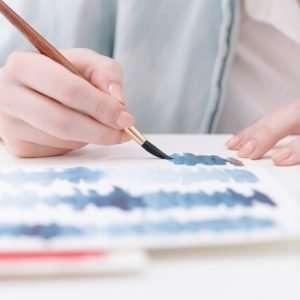 mani che dipingono
